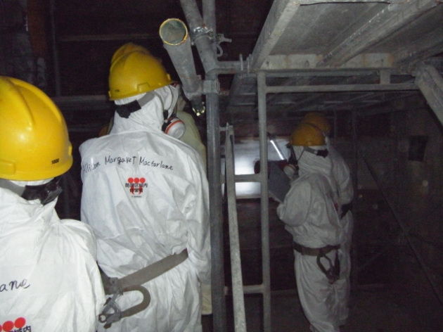NRC Chairman Allison Macfarlane and other NRC officials in the darkened interior of Reactor 4 at the Fukushima Dai-ichi nuclear complex northeast of Tokyo Dec. 13.
