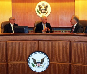 ALSB Panel Chief Administrative Judge Roy Hawkens (center) discusses Board business with ASLB Panel Associate Chief Administrative Judge Paul Ryerson (left) and ASLB Judge Alex Karlin in the Board's Hearing Facility at NRC Headquarters.