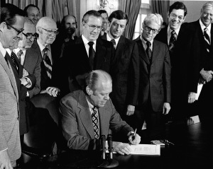President Gerald Ford signs the legislation that created the NRC.
