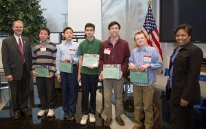NRC Deputy Executive Director Michael Weber (left) presents special awards for projects that relate to the agency's work. Also in the picture (left to right) students Richard Wang, Kevin Chen, Andrew Komo, Noah Kim, George Klees and the NRC's Kreslyon Fleming.
