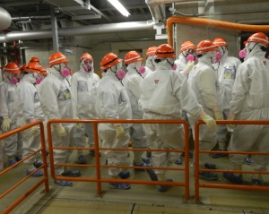 NRC officials tour one of the damaged units at the Fukushima Daiichi plant during their trip in February.