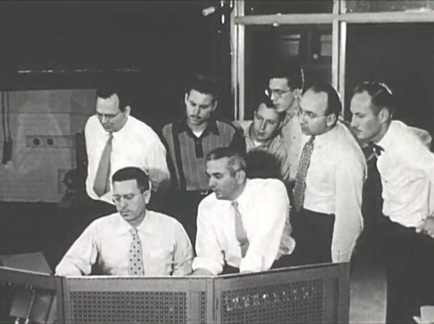 Five NC Stte physics professors designed the reactor. Here, in the reactor control room (left to right front row) are Clifford K. Beck and Arthur C. Menius, Jr. Standing is Newton Underwood, three unidentified students, Arthur Waltner and Raymond L. Murray.