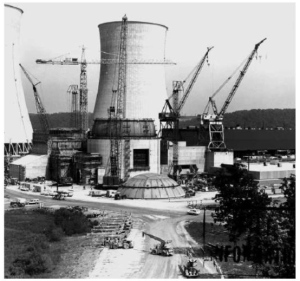 Numerous cranes helped complete construction of the Watts Bar Nuclear Plant Unit 1 containment building in front of the plant's cooling towers in 1977.