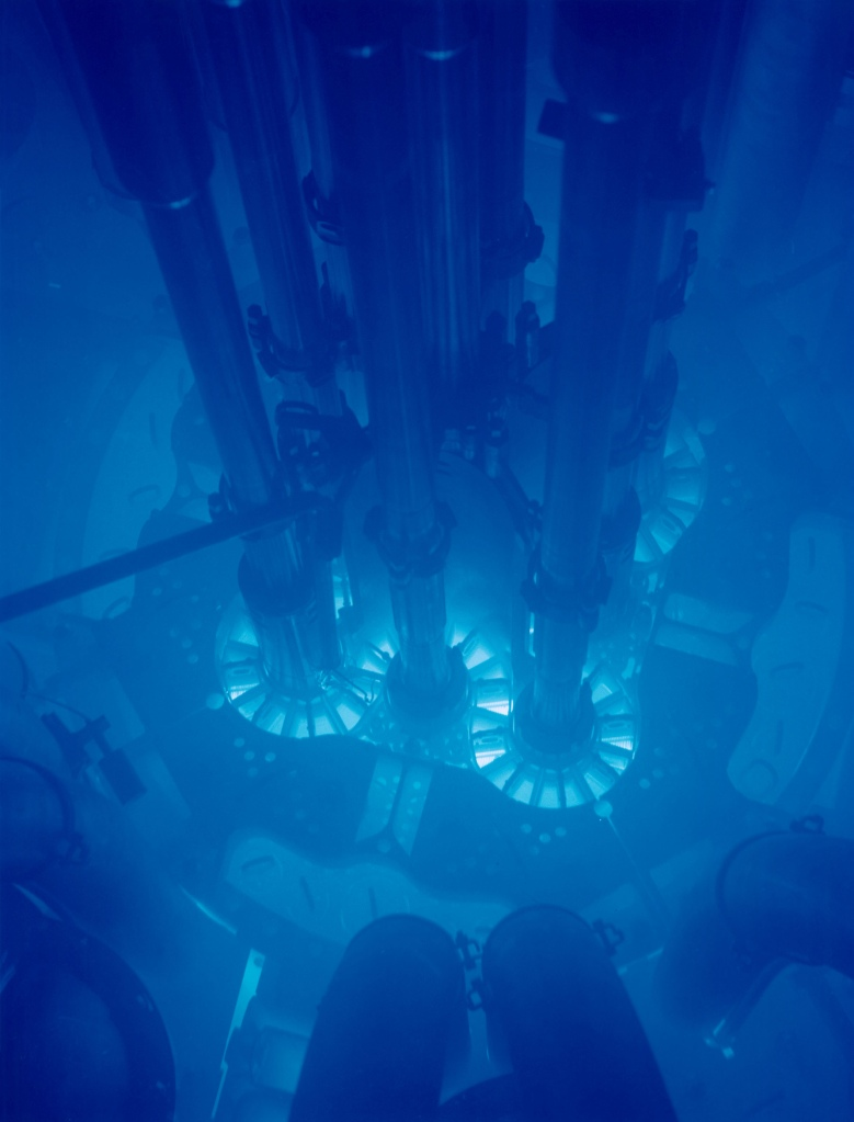 The Advanced Test Reactor at Idaho National Laboratory uses plate type fuel in a clover leaf arrangement. The blue glow around the core is known as Cherenkov radiation. Courtesy of Idaho National Laboratory.