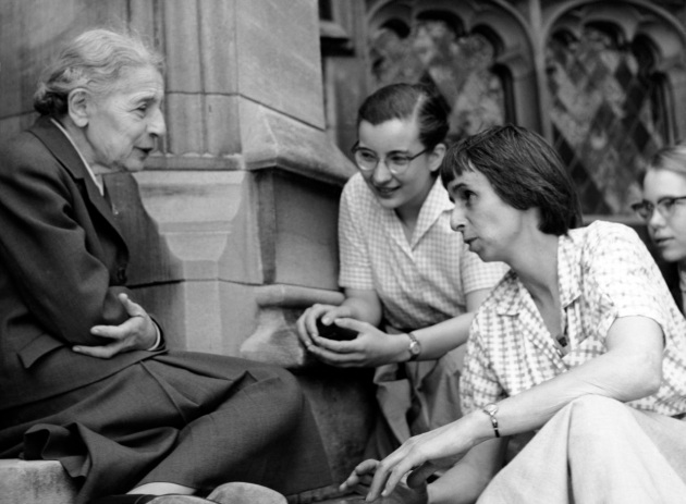 Chemist Lise Meitner with students (Sue Jones Swisher, Rosalie Hoyt and Danna Pearson McDonough) on the steps of the chemistry building at Bryn Mawr College. Courtesy of Bryn Mawr College. (April 1959)