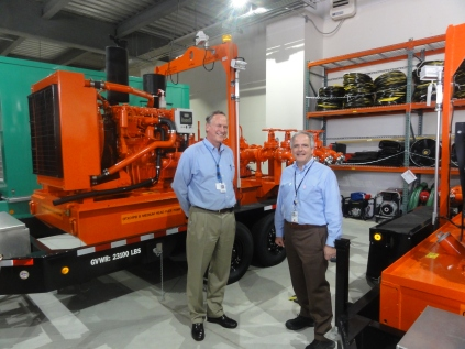 NRC Chairman Stephen Burns (right) stands with Jim Meister, Vice President for Operations Support, Exelon Generation, in front of portable equipment at the Braidwood nuclear plant. The equipment was purchased after Fukushima.