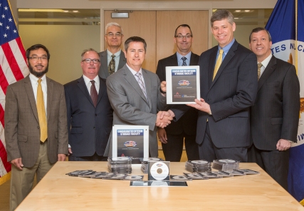 Officials from Waste Control Specialists deliver its application to construct and operate a consolidated interim storage facility to Joel Munday, Acting Deputy Director of the NRC's Office of Nuclear Material Safety and Safeguards.