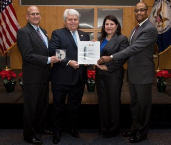 Michael Johnson, NRC Deputy Executive Director for Operations (right), and Vonna Ordaz, Acting Director of the Office of New Reactors (second from right) receive NuScale's application from NuScale Chief Nuclear Officer Dale Atkinson (second from left) and NuScale Vice President for Regulatory Affairs Tom Bergman (left).